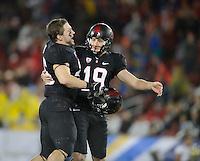 Stanford, Ca - Friday, November 30, 2012: Stanford won the Pac 12 Championships 27-24 over UCLA at Stanford University. Jodan Williamson celebrates with Matt Kasner.