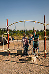 A family plays on a playground at Cooper Mountain.