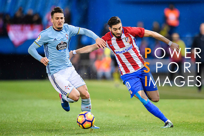 Yannick Ferreira Carrasco (r) of Atletico de Madrid battles for the ball with Nemanja Radoja of RC Celta de Vigo during their La Liga match between Atletico de Madrid and RC Celta de Vigo at the Vicente Calderón Stadium on 12 February 2017 in Madrid, Spain. Photo by Diego Gonzalez Souto / Power Sport Images