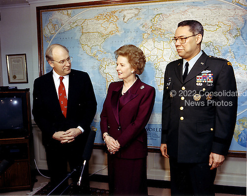 Washington, DC - (FILE) -- Former Prime Minister of the United Kingdom Margaret Thatcher, center, visited with Secretary of Defense Dick Cheney, left, and Chairman of the Joint Chiefs of Staff United States Army General Colin Powell, right, at the Pentagon on Thursday, March 7, 1991.  Among other topics of discussion was the success experienced by coalition forces, including air, land, and naval forces of both the United States and the United Kingdom, in securing the liberation of Kuwait during the recent Persian Gulf War..Credit: Robert D. Ward - DoD via CNP
