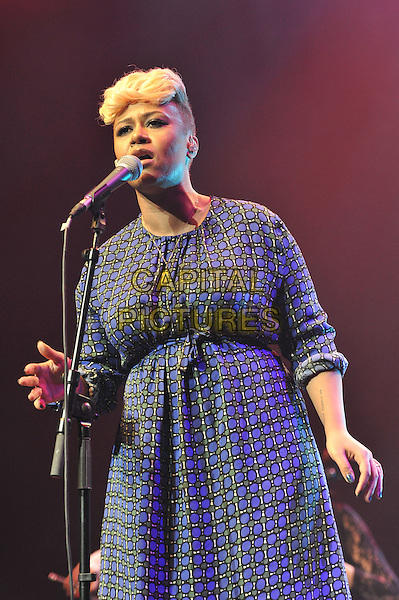 Emeli Sande.performing live as part of the EQUALS Live concert, Royal Festival Hall, London, England, UK, .9th March 2012..music concert gig  on stage half length microphone singing blue dress print  .CAP/MAR.© Martin Harris/Capital Pictures.