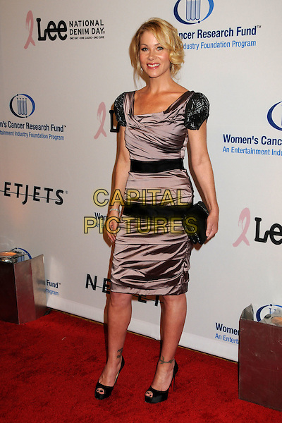 CHRISTINA APPLEGATE .EIF's Women's Cancer Research Fund Benefit held at the Beverly Wilshire Hotel, Beverly Hills, California, USA..January 27th, 2010.full length purple lilac beige grey gray silk satin dress black clutch bag shoulder pads .CAP/ADM/BP.©Byron Purvis/AdMedia/Capital Pictures.