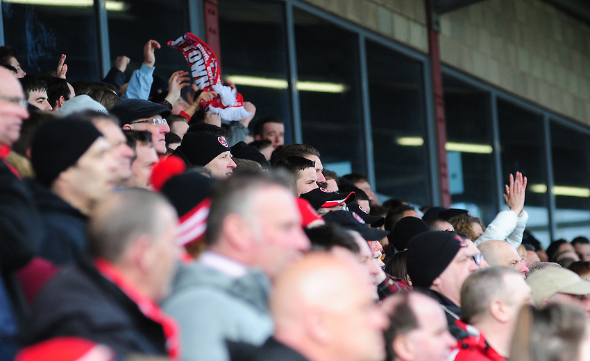 Fleetwood Town fans during their sides game against Preston North End<br /> <br /> Photographer Chris Vaughan/CameraSport<br /> <br /> Football - The Football League Sky Bet League One -  Fleetwood Town v Preston North End - Sunday 29th March 2015 - Highbury Stadium - Fleetwood<br /> <br /> &copy; CameraSport - 43 Linden Ave. Countesthorpe. Leicester. England. LE8 5PG - Tel: +44 (0) 116 277 4147 - admin@camerasport.com - www.camerasport.com