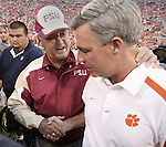 FSU head coach Bobby Bowden, left, greets Clemson head coach and his son Tommy Bowden at mid-field prior to the start of the 9th Annual Bowden Bowl between Florida State's Bobby Bowden and Clemson's Tommy Bowden in Clemson S.C. September 3, 2007.