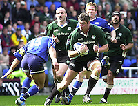 04/05/2002.Sport - Rugby Union.Zurich Premiership.London Irish vs Sale.Eddie Halvey, looking for the gap, is faced by Jason Robinson...[Mandatory Credit, Peter Spurier/ Intersport Images].