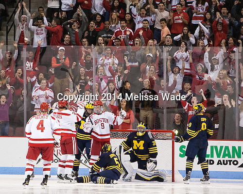 The Terriers and their fans celebrate Ahti Oksanen's (BU - 2) goal which tied the game 34 seconds into the second period. - The Boston University Terriers defeated the visiting University of Michigan Wolverines 3-2 on Saturday, October 25, 2014, at Agganis Arena in Boston, Massachusetts.