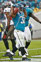 December 11, 2011:  Jacksonville Jaguars running back Maurice Jones-Drew (32) celebrates after scoring a touchdown during second half action between the Jacksonville Jaguars and the Tampa Bay Buccaneers played at EverBank Field in Jacksonville, Florida.  Jacksonville defeated Tamp Bay 41-14.........