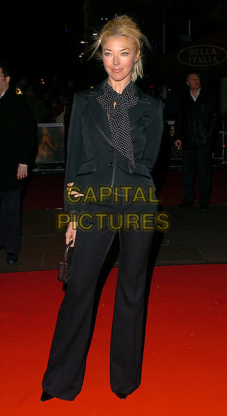 "TAMARA BECKWITH.At the Premiere of ""Casanova"",.Vue Cinema West End, London, England,.February 13th 2005..full length black and white polka dot spotty scarf jacket trousers.Ref: CAN.www.capitalpictures.com.sales@capitalpictures.com.©Capital Pictures"