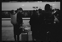 Commuters wait to board a high speed train at the Guiyang Main Station in Guiyang, Guizhou Province, 2018.