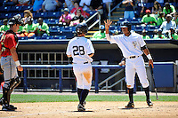 Staten Island Yankees first baseman Casey Stevenson #28 is greeted by teammate Angelo Gumbs #21 after hitting a homerun during a game against the State College Spikes at Richmond County Bank Ballpark at St. George on July 14, 2011 in Staten Island, NY.  Staten Island defeated State College 6-4.  Tomasso DeRosa/Four Seam Images