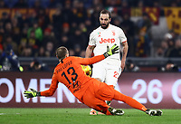 12th January 2020; Stadio Olympico, Rome, Italy; Italian Serie A Football, Roma versus Juventus; Gonzalo Higuain of Juventus with a good goal scoring opportunity saved by Lopez of Roma - Editorial Use