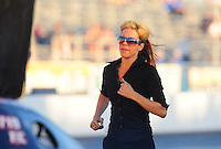 Oct. 14, 2011; Chandler, AZ, USA; NHRA funny car crew member Leeza Diehl backs up husband Jeff Diehl during qualifying at the Arizona Nationals at Firebird International Raceway. Mandatory Credit: Mark J. Rebilas-