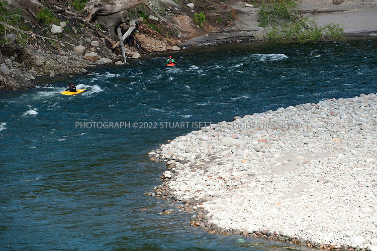 5/18/2009--Sandy, OR, USA..Kayakers Paul Kuthe (black helmet, yellow kayak) and Matt Preusch (writer: red helmet, orange kayak) kayak a recently opened stretch of the Sandy River in Oregon. The Marmot Dam was removed from the river in 2007 allowing fish and kayakers to travel the newly opened stretch of water...©2009 Stuart Isett. All rights reserved.