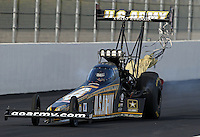 Feb. 15, 2013; Pomona, CA, USA; NHRA top fuel dragster driver Tony Schumacher has his parachutes tangle after running the top qualifying time during qualifying for the Winternationals at Auto Club Raceway at Pomona. Schumacher would take his car into the sand trap but stop short of hitting the catch net. Mandatory Credit: Mark J. Rebilas-