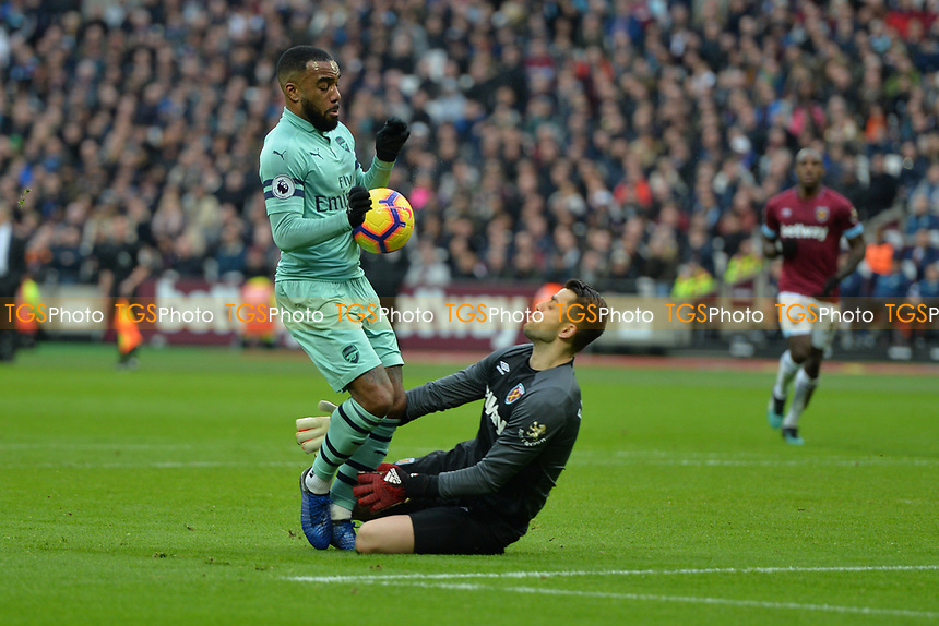 lukasz Fabianski of West Ham United comes out on Alexandre Lacazetten of Arsenal during West Ham United vs Arsenal, Premier League Football at The London Stadium on 12th January 2019