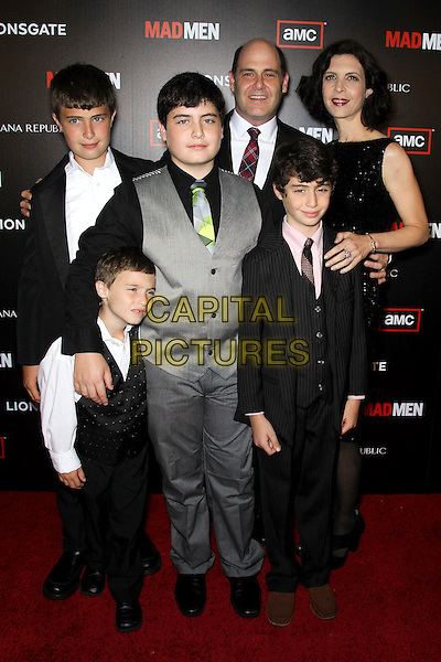 """MATTHEW WEINER AND FAMILY.at the Season 4 premiere of AMC's """"Mad Men"""", Mann Chinese 6 Theatre. Hollywood, CA, USA, July 20th, 2010. .full length wife sons children kids red plaid tartan tie suit grey gray waistcoat  dress black .CAP/CEL.©CelPh/Capital Pictures."""