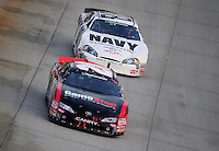 May 31, 2008; Dover, DE, USA; Nascar Nationwide Series driver Joey Logano (20) leads Brad Keselowski (88) during the Heluva Good 200 at the Dover International Speedway. Mandatory Credit: Mark J. Rebilas-US PRESSWIRE