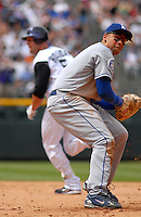 04 May 2008: LosAngeles Dodgers 1st baseman James Loney turns to throw to third base on a blooper play after tagging out Colorado Rockies left fielder Matt Holliday (also pictured). The Dodgers recorded one out on the play during the team's game on May 4, 2008 at Coors Field in Denver, Colorado. The Rockies defeated the Dodgers 7-2. FOR EDITORIAL USE ONLY