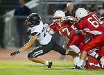 Lawndale, CA 09/26/14 - Andrew Ramirez (Lawndale #17), Rory Hubbard (Peninsula #22) and Brandon Ephriam (Lawndale #1) in action during the Palos Verdes Peninsula vs Lawndale CIF Varsity football game at Lawndale High School.  Lawndale defeated Peninsula 42-21
