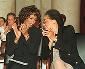 Whitney Houston and Marion Wright Edelman share thoughts during a October 1, 1997 press confrence in the historic Senate Caucus Room on Capitol Hill in Washington, D.C.  They were announcing the live benefit concert by Ms. Houston to be broadcast on HBO Sunday night, October 5.  The Children's Defense Fund, chaired by Ms. Edelman, will receive the benefits..Credit: Ron Sachs / CNP