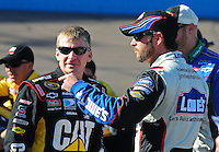 Apr 17, 2009; Avondale, AZ, USA; NASCAR Sprint Cup Series driver Jeff Burton (left) with Jimmie Johnson during qualifying for the Subway Fresh Fit 500 at Phoenix International Raceway. Mandatory Credit: Mark J. Rebilas-