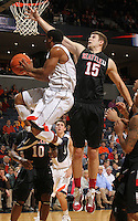 Dec. 22, 2010; Charlottesville, VA, USA; Seattle Redhawks forward Chad Rasmussen (15) defends Virginia Cavaliers guard Jontel Evans (1) during the game at the John Paul Jones Arena. Seattle Redhawks won 59-53. Mandatory Credit: Andrew Shurtleff