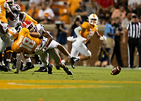 KNOXVILLE, TN - OCTOBER 5: Brian Maurer #18 of the Tennessee Volunteers is tackled by Eric Stokes #27 of the Georgia Bulldogs causing a fumble that was returned for a Georgia touchdown during a game between University of Georgia Bulldogs and University of Tennessee Volunteers at Neyland Stadium on October 5, 2019 in Knoxville, Tennessee.
