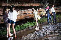 Chinese girls takes pictures under a waterfall in the Bamboo Sea National Park in Yibin, Sichuan, China, August 07, 2014<br /> <br /> Smartphones are an essential tool of Chinese ordinary life. Everywhere in China, people use them to take pictures to share online, to talk and chat, to play videogames, to get access to the mainstream information, to get connected one each other. In the country where the main global social media are forbidden - Facebook, Twitter and Youtube are not available  -, local social networks such as WeChat have a wide spread all over the citizens. The effect is an ordinary and apparently compulsive way to get easy access to digital technology and modern way of communication. <br /> A life through the display. Yes, We Chat.<br /> <br /> © Giorgio Perottino