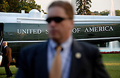 A United States Secret Service agent stands still as U.S. President Barack Obama departs the White House October 1, 2014 in Washington, DC. Julia Pierson, the director of the U.S. Secret Service, resigned Wednesday amid embarrassing new revelations of breaches to the protective cordon around President Obama. <br /> Credit: Olivier Douliery / Pool via CNP