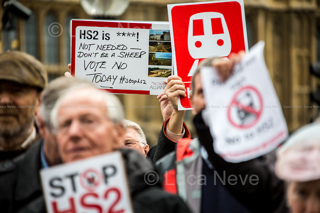 London, 28/04/2014. To mark the vote, taking place in the House of Commons (expected around 22:00), for the second reading of the HS2 Hybrid Bill, protesters gathered outside the Houses of Parliament to demonstrate against the 50 billion pounds high speed rail project which will connect London Euston to Birmingham City Centre.   <br />