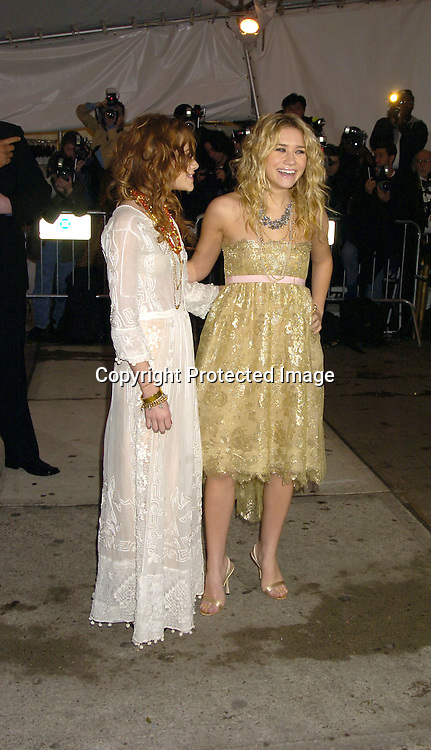 Mary-Kate and Ashley Olsen ..at The Metropolitan Museum of Art's Costume Institute Gala ..celebrating Chanel on May 2, 2005 in New York City.    Photo by Robin Platzer, Twin Images