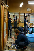Artisans at work at Gyokusendo, Tsubame, Niigata Pref, Japan, August 24, 2017. Traditional copper metalworking company Gyokusendo was founded in 1816 and is a registered as a traditional craft of Japan. At Gyokusendo, in a highly-skilled craft process, complex items such as teapots are beaten from a single sheet of copper using hammers and hundreds of other specialist tools.