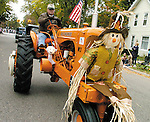 Sentinel/Dan Irving.Ed Ciaramita of Holland drives his 1950 Allis-Chalmers tractor in the Zeeland Pumpkinfest Parade Saturday..(10/8/05)