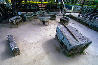 Indonesia, Sumatra. Samosir. Ambarita stone chairs. A prisoner with a death penalty were led to these stones were the medicine man drove out evil spirits with his staff. After the body was beheaded the King drank some of the blood to receive magical powers, while the meat was mixed with other kinds of meat and eaten by the people. The bones were thrown in the lake, where swimming and fishing was forbidden for a week.