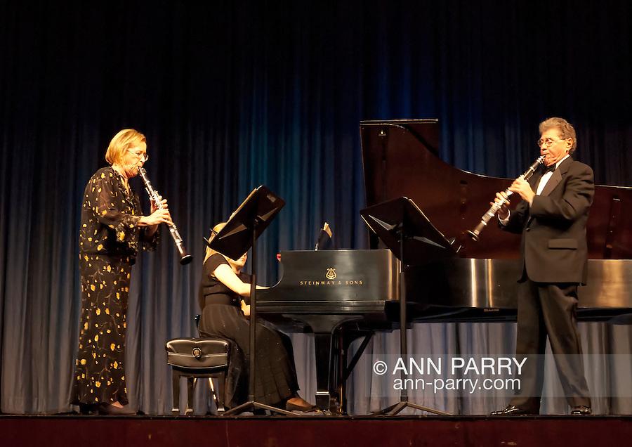 Stanley Drucker, world famous clarinetist and former member of New York Philharmonic for 60 years, and Naomi Drucker, clarinetist and her wife, performing at MBCCA Concert, New York, November 13, 2010