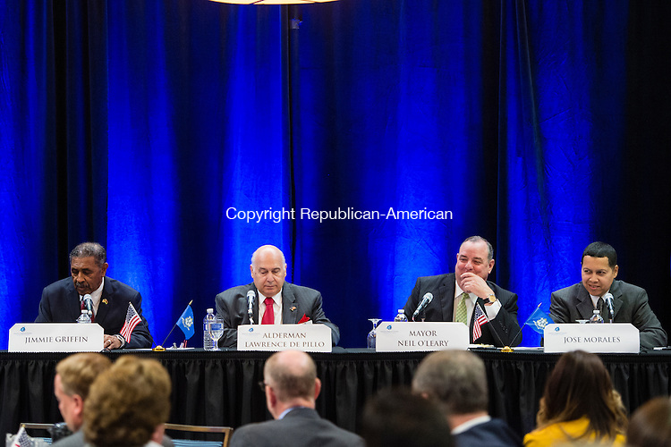 WATERBURY, CT- 14 October 2015-101415EC02-  Waterbury mayoral candidates share a light moment during Wednesday's Greater Waterbury Chamber of Commerce mayoral debate. From L to R: Jimmie Griffin, Lawrence De Pillo, Neil O'Leary and Jose Morales. Erin Covey Republican-American