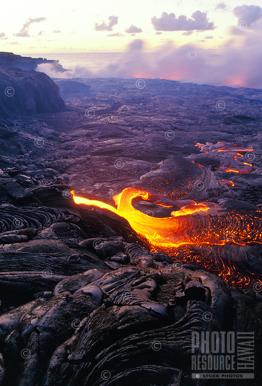 Kilauea lava flowing into the ocean at Hawaii volcanoes national park.