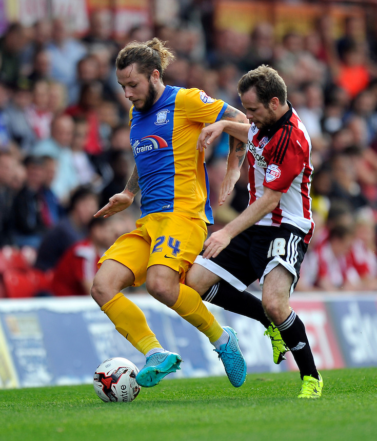 Preston North End's Stevie May holds off the challenge from Brentford's Alan Judge<br /> <br /> Photographer Ashley Western/CameraSport<br /> <br /> Football - The Football League Sky Bet Championship - Brentford v Preston North End - Saturday 19th September 2015 - Griffin Park - London<br /> <br /> &copy; CameraSport - 43 Linden Ave. Countesthorpe. Leicester. England. LE8 5PG - Tel: +44 (0) 116 277 4147 - admin@camerasport.com - www.camerasport.com