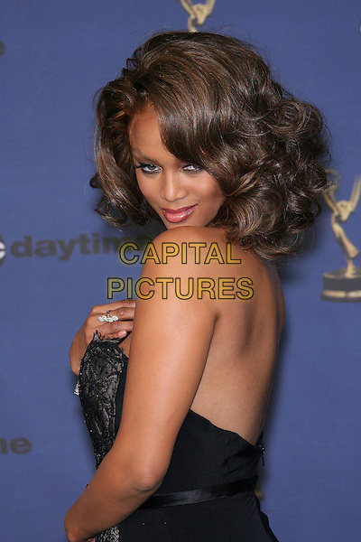 TYRA BANKS.The 33rd Annual Daytime Emmy Awards - Press Room held at the Kodak Theatre, Hollywood, California, USA, .28 April 2005..emmys half length strapless dress black lace back looking over shoulder behind.Ref: ADM/ZL.www.capitalpictures.com.sales@capitalpictures.com.©Zach Lipp/AdMedia/Capital Pictures.