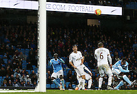 Yaya Toure of Manchester City scores his goal to make it 2-1 during the Barclays Premier League match between Manchester City and Swansea City played at the Etihad Stadium, Manchester on December 12th 2015