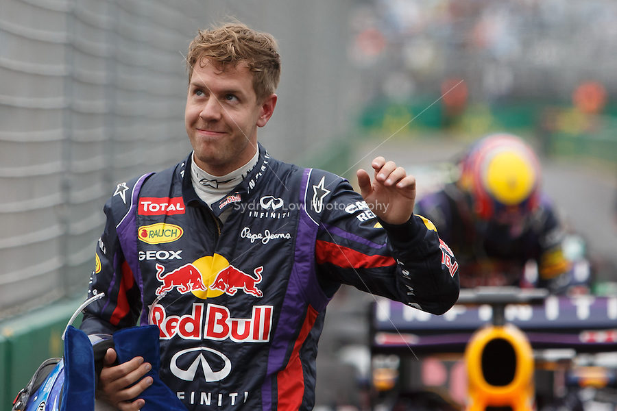 Sebastian Vettel (DEU) from the Infiniti Red Bull Racing team waves to the crowd after qualifying first on day four of the 2013 Formula One Rolex Australian Grand Prix at the Albert Park Circuit in Melbourne, Australia.