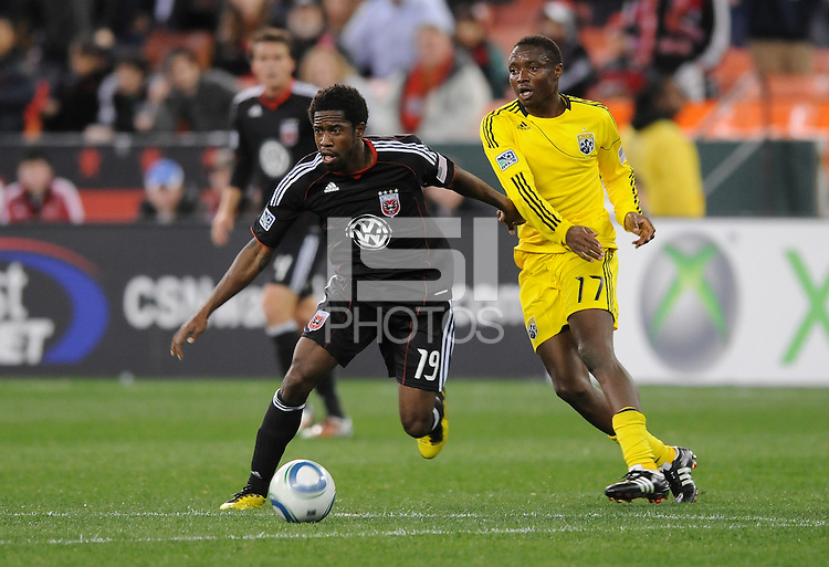 DC United midfielder Clyde Simms (19) runs from midfielder Emmanuel Ekpo (17)   DC United defeated The Columbus Crew 3-1  at the home season opener, at RFK Stadium, Saturday March 19, 2011.