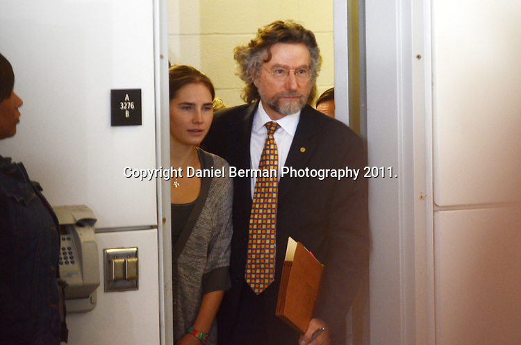 Amanda Knox and her criminal defense attorney Theodore Simon, enter to speak with the media upon her arrival at Seattle-Tacoma International Airport in Seattle Tuesday, October 4. Knox's murder conviction was overturned by an Italian appellate court after spending four years in prison in Italy. Photo by Daniel Berman/www.bermanphotos.com