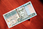 one Jordanian dinar currency note on table