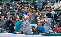 NWA Democrat-Gazette/BEN GOFF @NWABENGOFF<br /> Fans reach for a foul ball tossed to the stands Wednesday, May 16, 2018, at Arvest Ballpark in Springdale.