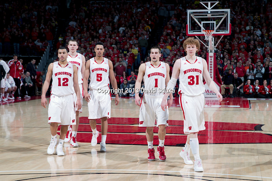 Wisconsin Badgers teammates Traevon Jackson (12), Jared Berggren (40), Ryan Evans (5), Ben Brust (1) and Mike Bruesewitz (31) look on during a Big Ten Conference NCAA college basketball game against the Michigan Wolverines Saturday, February 9, 2013, in Madison, Wis. The Badgers won 65-62 (OT) (Photo by David Stluka)