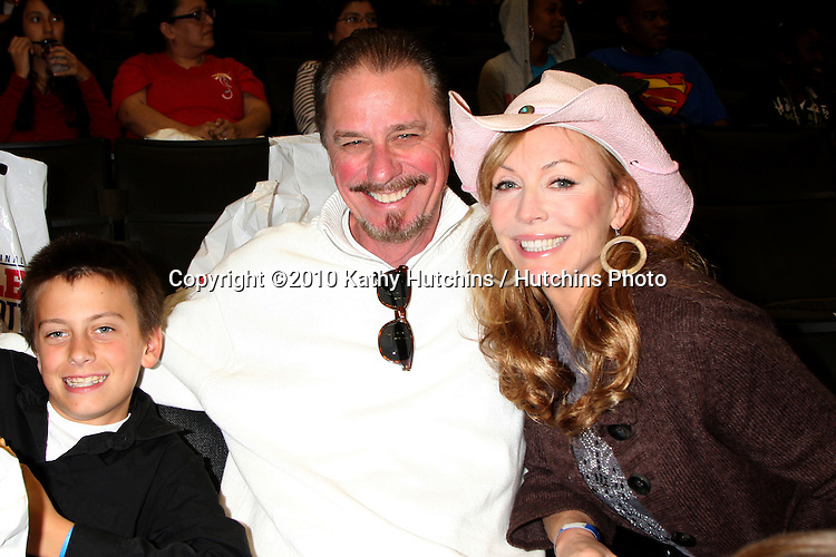 Lesley-Anne Down, husband, and son.at the Harlem Globetrotters Game .Staples Center.Los Angeles, CA.February 14, 2010.©2010 Kathy Hutchins / Hutchins Photo....