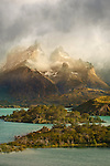 A morning rainstorm moves across the Cuernos del Paine in Torres del Paine National Park, Patagonia, Chile.