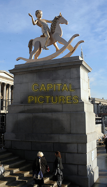Child On A Rocking Horse' installation.Joanna Lumley  reveals the 'Child On A Rocking Horse' installation by Scandinavian artistic duo Elmgreen & Dragset on the fourth plinth, Trafalgar Square, London, England, UK, .24th February 2012..bronze art work sculpture statue  gv general view g.v. .CAP/WIZ.© Wizard/Capital Pictures.