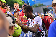Washington, DC - July 23, 2016: Gael Monfils signs autographs after winning his semi-final match against Alexander Zverev in the Citi Open at the Rock Creek Park Tennis Center in the District of Columbia, July 23, 2016  (Photo by Don Baxter/Media Images International)